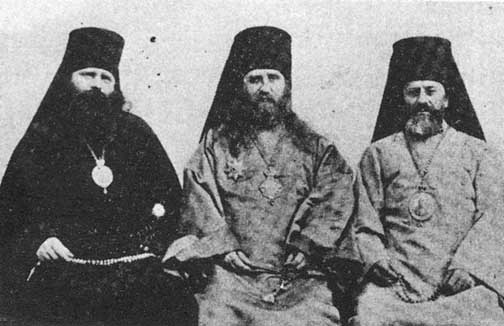 St. Tikhon, flanked by his two vicars, Bishop Innocent and St. Raphael