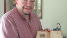 Nicholas Chapman with Philip Ludwell's personal copy of his book The Orthodox Confession