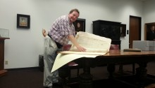 Nicholas Chapman with Ludwell estate documents in Austin, TX.