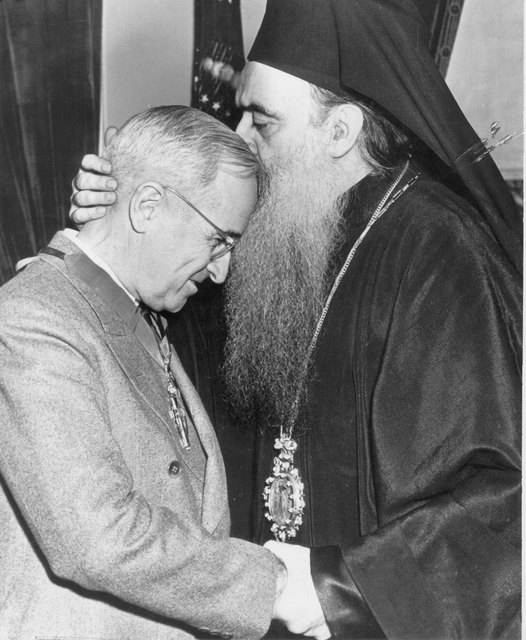 Archbishop Athenagoras kisses President Truman after giving him a piece of the True Cross.